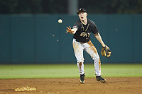 Josh White (3) of the Army Black Knights flips the ball towards second base during the game against the Auburn Tigers at Doak Field at Dail Park on June 2, 2018 in Raleigh, North Carolina. The Tigers defeated the Black Knights 12-1. (Brian Westerholt/Four Seam Images)