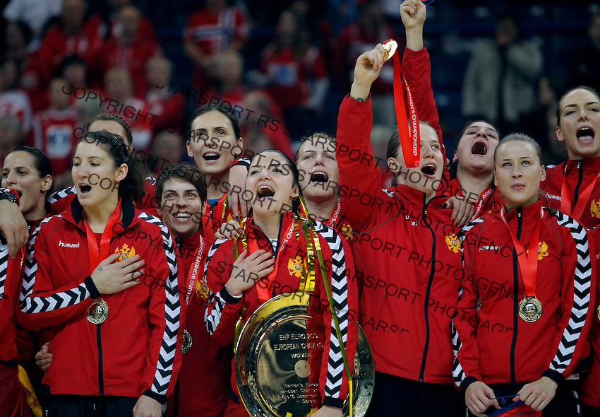 BELGRADE, SERBIA - DECEMBER 16: Montenegro handball team sing national anthem with the trophy during the Women's European Handball Championship 2012 medal ceremony at Arena Hall on December 16, 2012 in Belgrade, Serbia. (Photo by Srdjan Stevanovic/Getty Images)