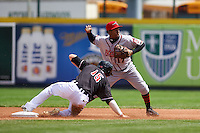 Richmond Flying Squirrels shortstop Rando Moreno (17) throws to first as Connor Harrell (15) slides in during a game against the Erie Seawolves on May 20, 2015 at Jerry Uht Park in Erie, Pennsylvania.  Erie defeated Richmond 5-2.  (Mike Janes/Four Seam Images)