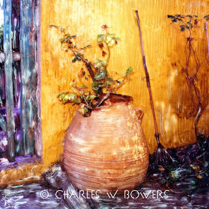Great urn with an even greater geranium survivor.