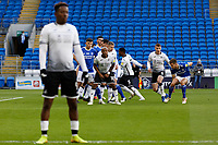 Andre Ayew of Swansea City (C) and team mates prepare for a team mate's free kick during the Sky Bet Championship match between Cardiff City and Swansea City at the Cardiff City Stadium, Cardiff, Wales, UK. Saturday 12 December 2020