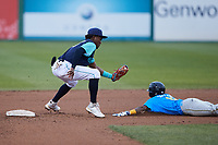 Lynchburg Hillcats shortstop Angel Martinez (13) prepares to tag out Yeison Santana (16) of the Myrtle Beach Pelicans as he attempts to steal second base at Bank of the James Stadium on May 22, 2021 in Lynchburg, Virginia. (Brian Westerholt/Four Seam Images)