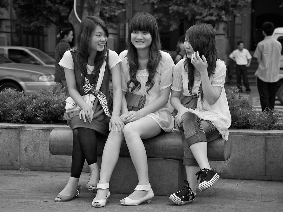 Three Friends Take A Break On The Bund, Guangzhou, China.