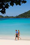 Seychelles, Island Mahe, Port Launay, Anse Souillac: Port Launay Marine National Park - couple walking the beach<br />