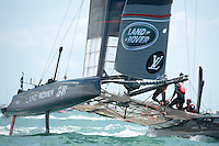 25 July 2015: Land Rover BAR prepares to round the windward mark during the America's Cup first round racing off Portsmouth, England (Photo by Rob Munro)