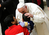 Pope Francis kisses a child at the end of his weekly general audience in the Paul VI hall at the Vatican, January 22, 2020.<br />