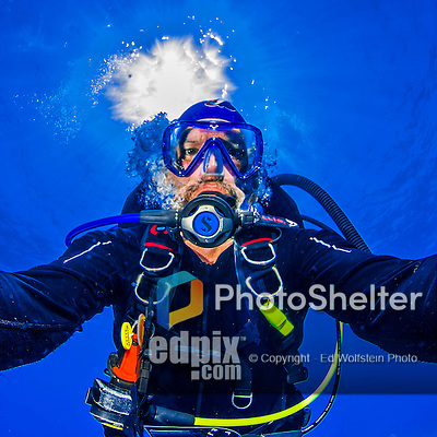 """22 July 2015: SCUBA Diver Ed Wolfstein poses for an underwater """"selfie"""" image at Ocean Pointe Reef, on the North Shore of Grand Cayman Island. Located in the British West Indies in the Caribbean, the Cayman Islands are renowned for excellent scuba diving, snorkeling, beaches and banking.  Mandatory Credit: Ed Wolfstein Photo *** RAW (NEF) Image File Available ***"""