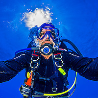 "22 July 2015: SCUBA Diver Ed Wolfstein poses for an underwater ""selfie"" image at Ocean Pointe Reef, on the North Shore of Grand Cayman Island. Located in the British West Indies in the Caribbean, the Cayman Islands are renowned for excellent scuba diving, snorkeling, beaches and banking.  Mandatory Credit: Ed Wolfstein Photo *** RAW (NEF) Image File Available ***"
