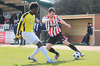 Martin Tuohy of Hornchurch seeks to evade Helge Orome of Bromley - AFC Hornchurch vs Bromley - Blue Square Conference South Football at The Stadium, Upminster Bridge, Essex - 01/04/13 - MANDATORY CREDIT: Gavin Ellis/TGSPHOTO - Self billing applies where appropriate - 0845 094 6026 - contact@tgsphoto.co.uk - NO UNPAID USE.