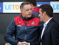 (L-R) Tony Roberts is greeted by Watford manager Marco Silva during the Premier League match between Swansea City and Watford at The Liberty Stadium, Swansea, Wales, UK. Saturday 23 September 2017