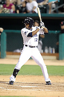 Cedric Hunter #12 of the Tucson Padres plays in a Pacific Coast League game against the Fresno Grizzlies at Kino Stadium on April 20, 2011  in Tucson, Arizona. .Photo by:  Bill Mitchell/Four Seam Images.