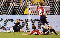 Chivas USA goalkeeper Lance Parker dives to his right making a save as teammates Carey Talley (ground) and Jesse Marsch (standing) look on helplessly. The LA Galaxy defeated Chivas USA 1-0 to win the final edition of the 2009 SuperClásico at Home Depot Center stadium in Carson, California on Saturday, August 29, 2009...