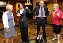 Kathy Bourgeois, left, talks to political consultants Mary Matalin and James Carville, and Melinda Schwegmann before the husband and wife team deliver their keynote address at the Louisiana Center for Women & Government luncheon in New Orleans, Saturday, March 28, 2009..