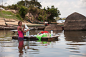Xingu River, Para State, Brazil. Ilha da Fazenda settlement. Caboclo girl washing clothes in the river.