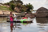 Xingu River, Para State, Brazil. Ilha da Fazenda settlement. Caboclo girl washing clothes in the river.
