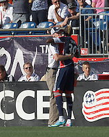 Waterboy gets a celebratory hug after New England Revolution forward Saer Sene (39) scores a goal. In a Major League Soccer (MLS) match, the New England Revolution (blue) defeated LA Galaxy (white), 5-0, at Gillette Stadium on June 2, 2013.