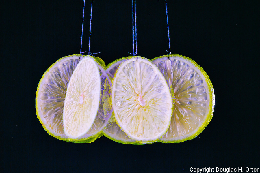 Slice of lime swinging on black background. Fruit, Food, multiple exposure, food in motion, unique food photo, in studio