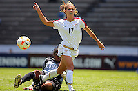 Alex Morgan of USA is slide tackled by a Cuba player during CONCACAF U-20 Women's World Cup qualifying tournament in Puebla, Mexico. The USA defeated Cuba, 9-0.