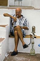 Tunisia, Sidi Bou Said.  Man Smoking a Sheesha, Cafe Sidi Sha'ban.