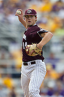 Texas A&M Aggies pitcher Kyle Simonds (14) makes a pickoff throw to first base during the Southeastern Conference baseball game against the LSU Tigers on April 25, 2015 at Alex Box Stadium in Baton Rouge, Louisiana. Texas A&M defeated LSU 6-2. (Andrew Woolley/Four Seam Images)