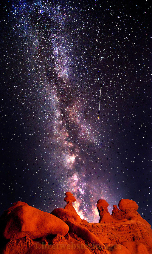 A shooting star is caught in Goblin Valley near the San Rafael Swell in Utah. The Milky Way backs the majestic hoodoos on the ridge.