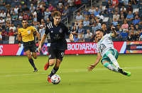 KANSAS CITY, KS - AUGUST 10: Wilson Harris #96 of Sporting Kansas City  tries to elude Ramiro Gonzalez #23 of Club Leon FC during a game between Club Leon FC and Sporting KC at Children's Mercy Park on August 10, 2021 in Kansas City, Kansas.