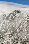 Tuckerman Ravine in extreme weather conditions from Boott Spur Trail in the White Mountains, New Hampshire USA during the winter months. Strong winds cause snow to blow across the mountain tops.