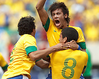 Brazil midfielder Romulo (8) celebrates his goal with teammates. In an international friendly (Clash of Titans), Argentina defeated Brazil, 4-3, at MetLife Stadium on June 9, 2012.
