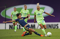 30th August 2020, San Sebastien, Spain;  Pernille Harder of VfL Wolfsburg is slide tackled by Saki Kumagai of Lyon during the UEFA Womens Champions League football match Final between VfL Wolfsburg and Olympique Lyonnais.