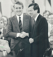 1987 FILE PHOTO - ARCHIVES -<br /> <br /> Welcomes Quebec: Prime Minister Brian Mulroney; left; shakes hands with Quebec Premier Robert Bourassa yesterday as the 11 first ministers signed the deal which finally brings Quebec into the 1982 Canadian Constitution. Parliament and the provincial legislatures must still ratify the deal.<br /> <br /> 1987<br /> <br /> PHOTO : Boris Spremo - Toronto Star Archives - AQP