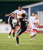 Dwayne De Rosario (7) of D.C. United is fouled by Tim Cahill (17) of the New York Red Bulls during the game at RFK Stadium in Washington, DC.  D.C. United tied the New York Red Bulls, 2-2.