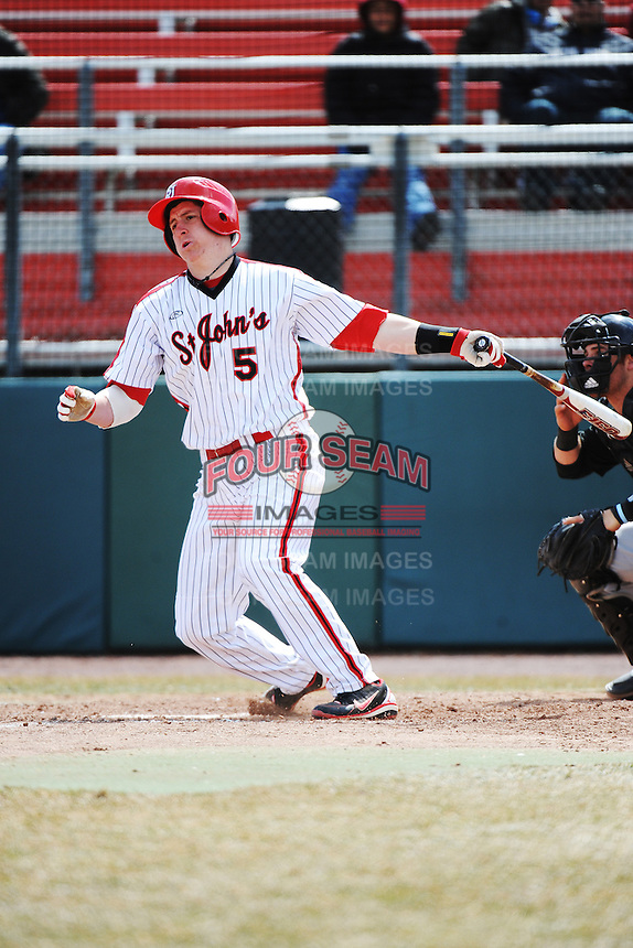 St. John's University Redstorm infielder Frank Schwindel (5) during game 1 of a double header against the University of Cincinnati Bearcats at Jack Kaiser Stadium on March 28, 2013 Queens, New York.  St. John's defeated Cincinnati 6-5 in game 1.                                                                 (Tomasso DeRosa/ Four Seam Images)