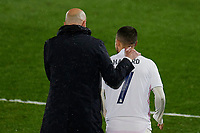 April 27th 2021; Alfredo Di Stefano Stadium, Madrid, Spain;  UEFA Champions League. Real Madrid coach Zinedine Zidane speaks with substitute Eden Hazard of Real Madrid during the Champions League match, semifinals between Real Madrid and Chelsea FC played at Alfredo Di Stefano Stadium