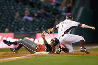 Tom Wertz #1 of the Houston Cougars over slides third base and is eventually tagged out by Caleb Shofner #1 of the Texas A&M Aggies in the 2009 Houston College Classic at Minute Maid Park March 1, 2009 in Houston, TX.  The Aggies defeated the Cougars 5-3. (Photo by Brian Westerholt / Four Seam Images)