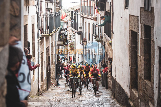 The peloton led by Team Jumbo-Visma with race leader Primoz Roglic (SLO) Red Jersey pass through Candelario during Stage 17 of the Vuelta Espana 2020, running 178.2km from Sequeros to Alto de la Covatilla, Spain. 7th November 2020.  <br /> Picture: Unipublic/Charly Lopez | Cyclefile<br /> <br /> All photos usage must carry mandatory copyright credit (© Cyclefile | Unipublic/Charly Lopez)
