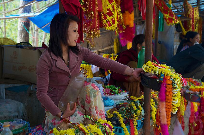 Selling flowers and other items at the entrance of the temple at Dakshinkall Bungamati, Khokana Animal sacrifice Temple, Kathmandu, Nepal