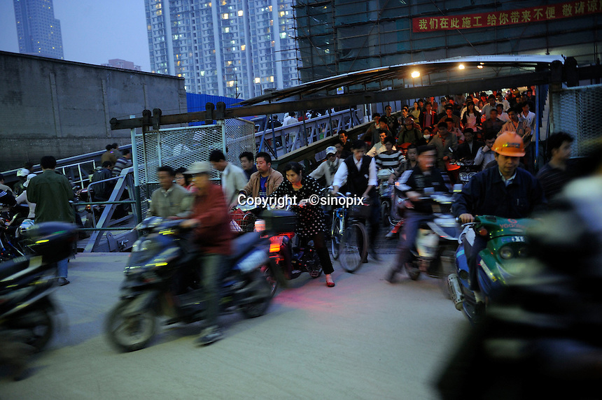 People working in Pudong rush to Puxi off work at a ferry in Shanghai, China..16 Oct 2009