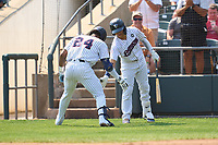 Somerset Patriots Isiah Gilliam (24) celebrates hitting a home run with Jesus Bastidas (1) during a game against the Hartford Yard Goats on September 12, 2021 at TD Bank Ballpark in Bridgewater, New Jersey.  (Mike Janes/Four Seam Images)