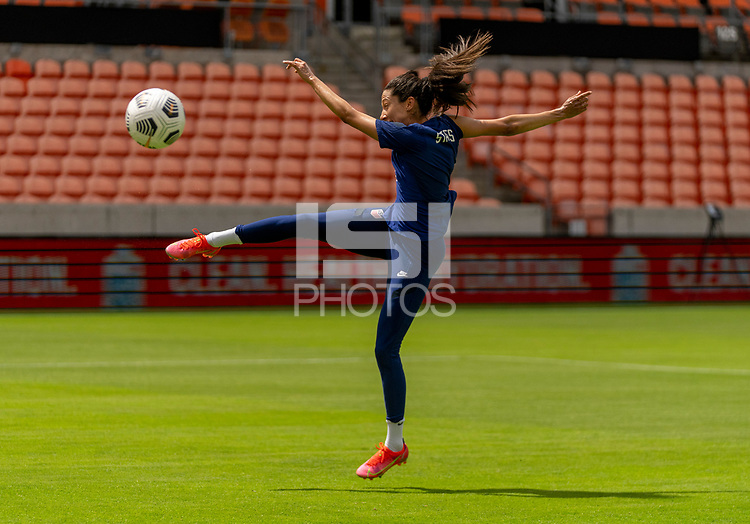 HOUSTON, TX - JUNE 9: Christen Press #23 of the USWNT takes a shot during a training session at BBVA Stadium on June 9, 2021 in Houston, Texas.