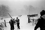 Guns are checked as snowfall limits visibility, opening day of deer season, near Kalona, 2005