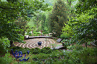 Labyrinth maze of stepping stones in garden room in woodland clearing;  Taylor garden
