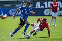SAN JOSE, CA - APRIL 24: Andres Rios #25 of the San Jose Earthquakes dribbles past Andres Ricaurte #10 of FC Dallas during a game between FC Dallas and San Jose Earthquakes at PayPal Park on April 24, 2021 in San Jose, California.