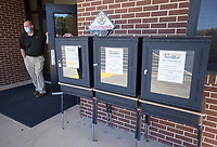 Principal Michael Wells looks on standing next to contactless pick-up boxes, Monday, October 5, 2020 at Clinton Junior High School in Clinton. Check out nwaonline.com/2010010Daily/ for today's photo gallery. <br /> (NWA Democrat-Gazette/Charlie Kaijo)
