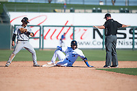 Surprise Saguaros third baseman Vladimir Guerrero Jr. (27), of the Toronto Blue Jays organization, relaxes after sliding into second base and being called safe by umpire John Bacon as Bryson Brigman (15) looks on in the ninth inning of an Arizona Fall League game against the Salt River Rafters on October 9, 2018 at Surprise Stadium in Surprise, Arizona. The Rafters defeated the Saguaros 10-8. (Zachary Lucy/Four Seam Images)