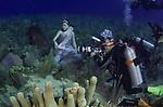 Underwater model, Hidy Yu, with Michael Aw and groupers, Cuba Underwater, Jardines de la Reina, Protected Marine park underwater