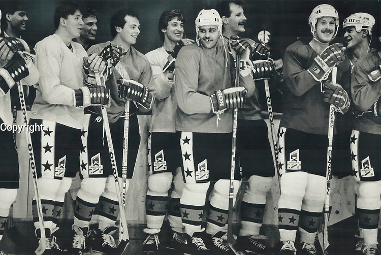 1987 FILE PHOTO - ARCHIVES -<br /> <br /> Guess who's winning Rendez-Vous series? Winning sure is fun. And Team NHL's 4-3 victory over the Soviets Wednesday night certainly showed in the faces of players on the respective teams at yesterday's practice sessions. While the NHL stars wore broad grins and joked among themselves during the team's workout at the Quebec Colisee; this Soviet trio had little to smile about and mirrored the expression on the face of their ever taciturn coach; Viktor Tikhonov.<br /> <br /> PHOTO :  Jeff Goode - Toronto Star Archives - AQP