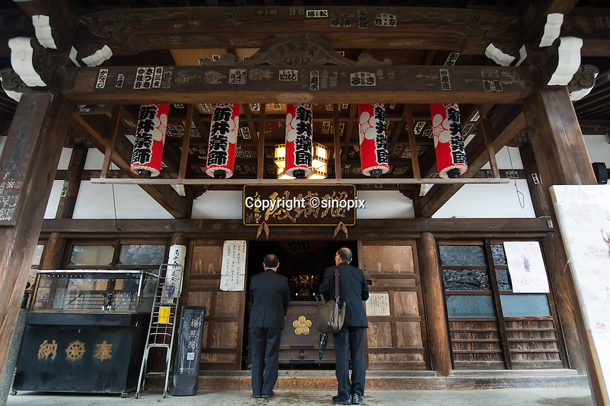 Old people pray Araiyakushi Baishoin temple near Araiyakushimae station on seibu Shinjuku line in Nakano, Tokyo