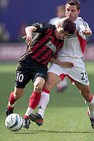MetroStars' Joselito Vaca battles  for the ball with D.C. United's Dema Kovalenko. D. C. United was defeated by the NY/NJ MetroStars 3 to 2 during the MetroStars home opener at Giant's Stadium, East Rutherford, NJ, on April 17, 2004.
