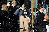 People enjoy the hourly artificial snow falling in the West Piazza at Covent Garden, London on Saturday December 19th 2020<br /> <br /> Photo by Keith Mayhew