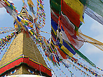Strings of prayer flags fluttering in the wind at Boudhanath stupa, Nepal